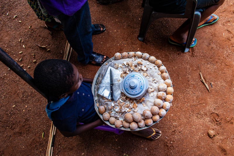 <p>A small boy selling boiled eggs at a dancing festival in Hohoe, Volta Region, Ghana. </p>